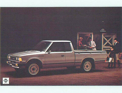 Unused Pre-1980 postcard ad DATSUN KING CAB PICKUP TRUCK BY NISSAN k8972