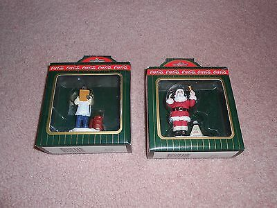 Two 1996 Coca Cola Town Square Figurines Shopkeeper & Charity Santa Retired