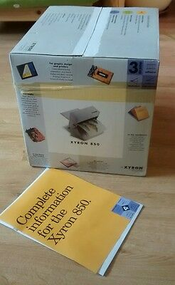 Xyron 850 machine - laminates, adds adhesive. Ideal for craft and scrapbooking