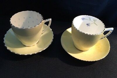 A Pair Of Two Mintons Yellow Two Cup And Saucers Hand Painted Inside