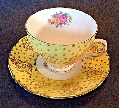 Colcough Pedestal Tea Cup And Saucer - Yellow And Gold With Colorful Bouquets