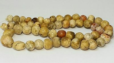 A LARGE STRAND OF ANCIENT PATINIZED AGATE & CARNELIAN BEADS (46cm)