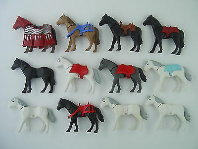 "12x Playmobil Horses, some with Saddles, one with Cape, marked ""Playmobil"""