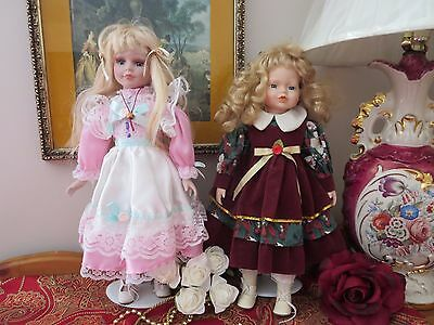 Porcelain Dolls - 2 pre-owned - Collectibles with Blond Hair 15in and16in.