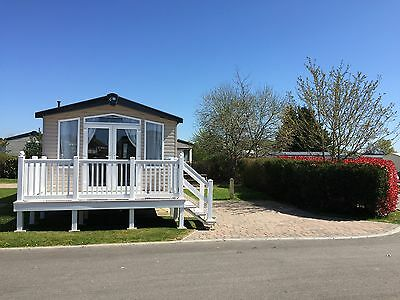 Luxury modern caravan with decking on Haven's Weymouth Bay