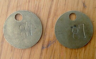 Pair of tokens......tool ckecks? Both numbered '87'