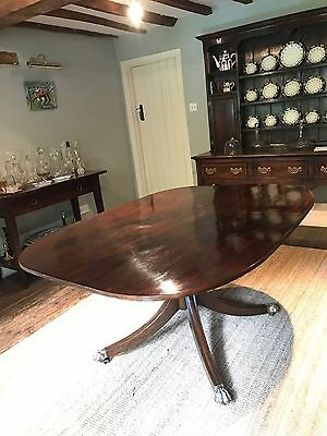 Antique Regency mahogany tilt-top dining table