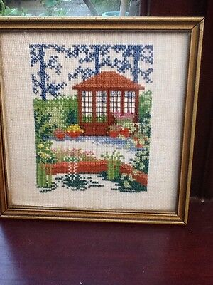 Completed cross stitch framed Of A Garden And Sun Room 21cm Square