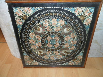 old victorian tapestry in a wood frame and glass top