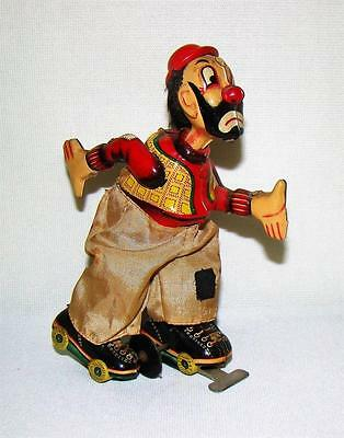 Vintage T.p.s. Japan Tin Litho Skating Clown Wind Up Toy