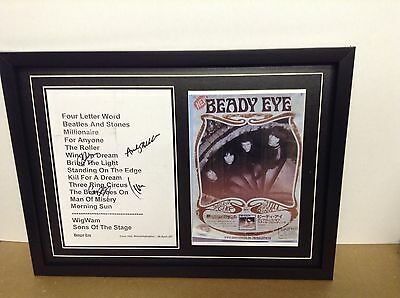 Beady Eye Hand Signed/Autographed Songsheet with a Poster and COA
