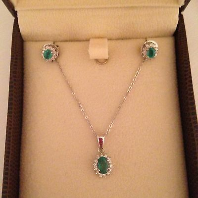 Exquisite matching 18ct white gold, emerald and Diamond, pendant and earrings f