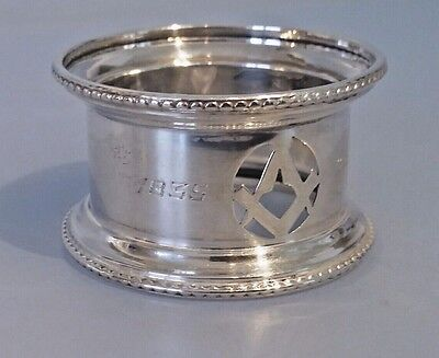 Silver masonic napkin ring  with pierced Square & compasses engraved 1835-1931