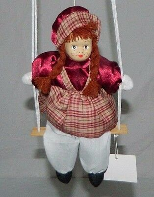 Girl Doll Made Of Porcelain Hanging On A Swing Miniature