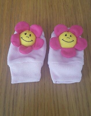 Baby mittens with flower rattle on each mitten