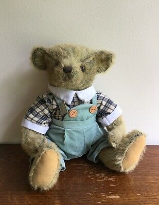 teddy bear deans badge sitting dressed