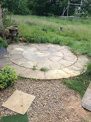 Circular weathered cast stone patio 40mm flags tiles approx 3.4m diameter
