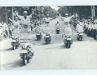 Pre-Chrome foreign MOTORCYCLE PARADE HAS ADVERTISING FOR CINZANO VERMOUTH HL9761