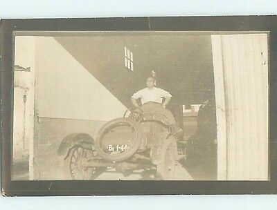 1925 rppc SPARE TIRE ON BACK OF CAR at automobile car garage in Mexico HM1561