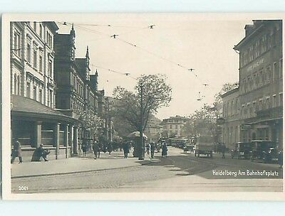 old rppc OLD CARS BY SHOPS ON STREET Heidelberg Germany HM1663