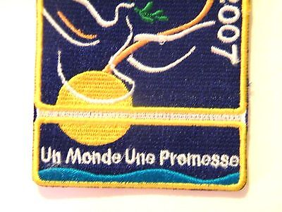 FRENCH 2007 World Scout Centenary Badge ONE WORLD ONE PROMISE 100 years Scouts