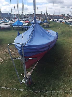 15' Wayfarer mark 2 sailing dinghy, red hull with cream topsides.