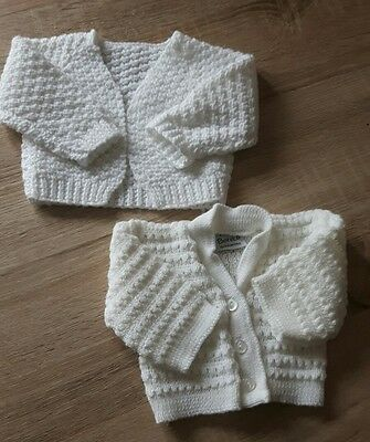 2 White Knitted unisex cardigans. Size 0-3 months