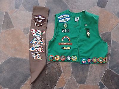 Brownie girl scout sash and Junior vest