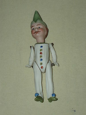 Vintage interesting small bisque porcelain doll hand painted movable limbs!