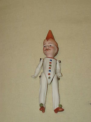 Vintage interesting small bisque porcelain doll hand painted red movable limbs!