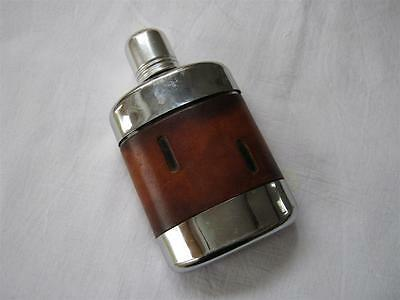 Vintage Glass Hip Flask with leather cover and polished stainless steel trim.