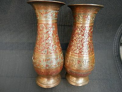 Pair of beautifully decorated brass Indian vases.