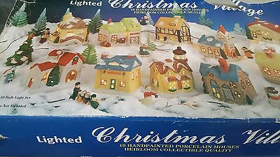 Porcelain lighted christmas village ten houses w/ lights in its original box