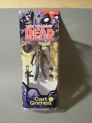 Action Figuren - MC FARLANE WALKING DEAD CARL GRIMES