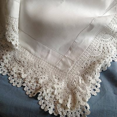 White vintage line table cloth with a deep curved  lace edge all round
