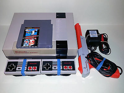 Nintendo NES Console with 2 controllers, zapper and Super Mario Bros / Duck Hunt