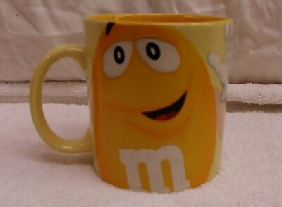 M&M yellow coffee mug tea cup large candy chocolate beverage