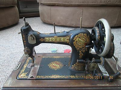 vintage  jones sewing machine with case and old sewing items