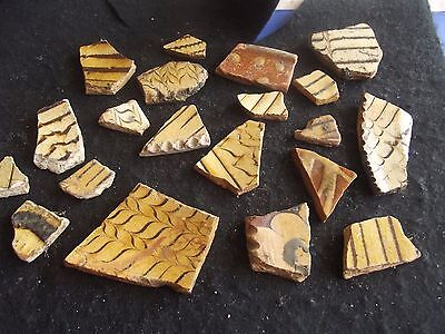 Medieval/post medieval pottery shards Brushed slipware
