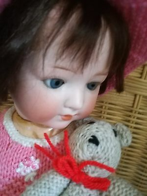 Heubach320 baby girl with pierced nostrils