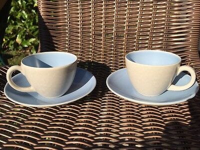 A Pair Of Poole Pottery Cup And Saucers