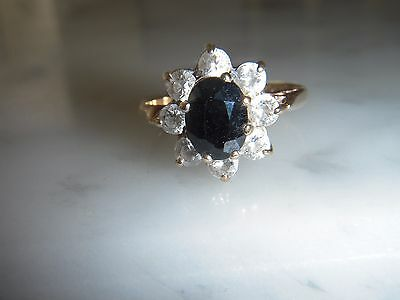 A Stunning Oval Blue Sapphire  And White Sapphire 9 Ct Gold Cluster Ring