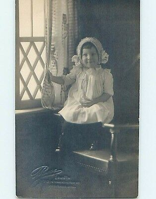 Pre-1918 rppc CHILD PULLING ON CURTAIN Embossed Portland Oregon OR HM3131