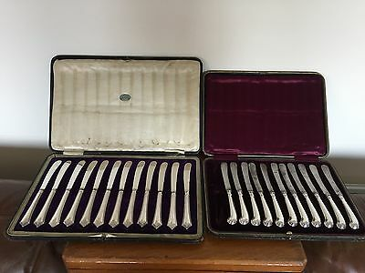 2 Cased Sets Of Solid Silver Sheffield Hallmarked Butter Knives  (12 & 11)