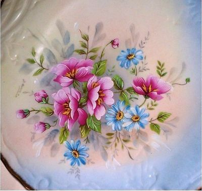 FRENCH LIMOGES PLATE Decorated in a stunning floral display