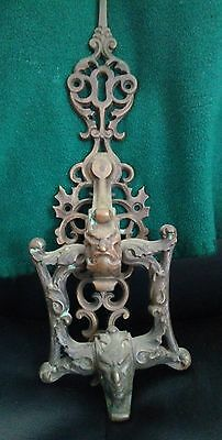 antique figural cast brass door knocker with 2 devils 14 inches in lenth