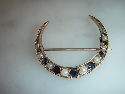 A Beautiful Art Deco 9Ct Gold Blue Sapphire And Pearl Crescent Brooch