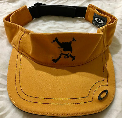Authentic new Oakley visor. Adjustable. Yellow/gold with black