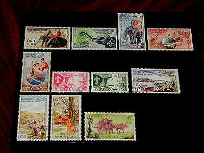 Laos stamps - 11 mint hinged and used early stamps - nice group !!