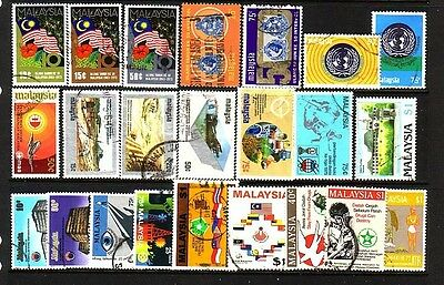 MALAYSIA....  Collection of 23 different used stamps includes Tin mining set